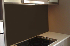 chocolate coloured glass kitchen splashback