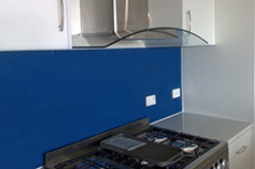 dark blue glass splashback
