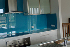 light blue coloured glass splashback in kitchen