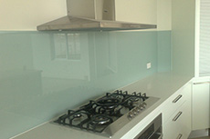light grey glass splashback