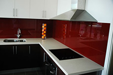 red glass splashback in kitchen