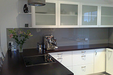 silver coloured glass splashback